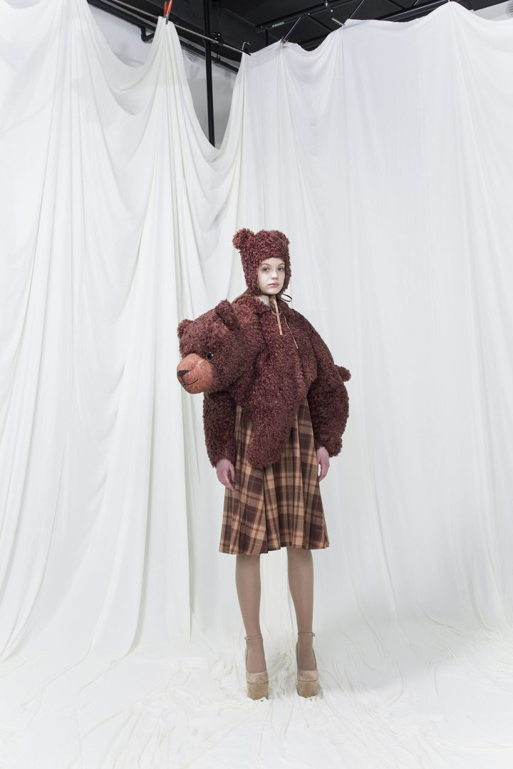 Brown brushed fur resembling a stuffed bear, brown checked dress underneath and a brushed fur hat with ears.