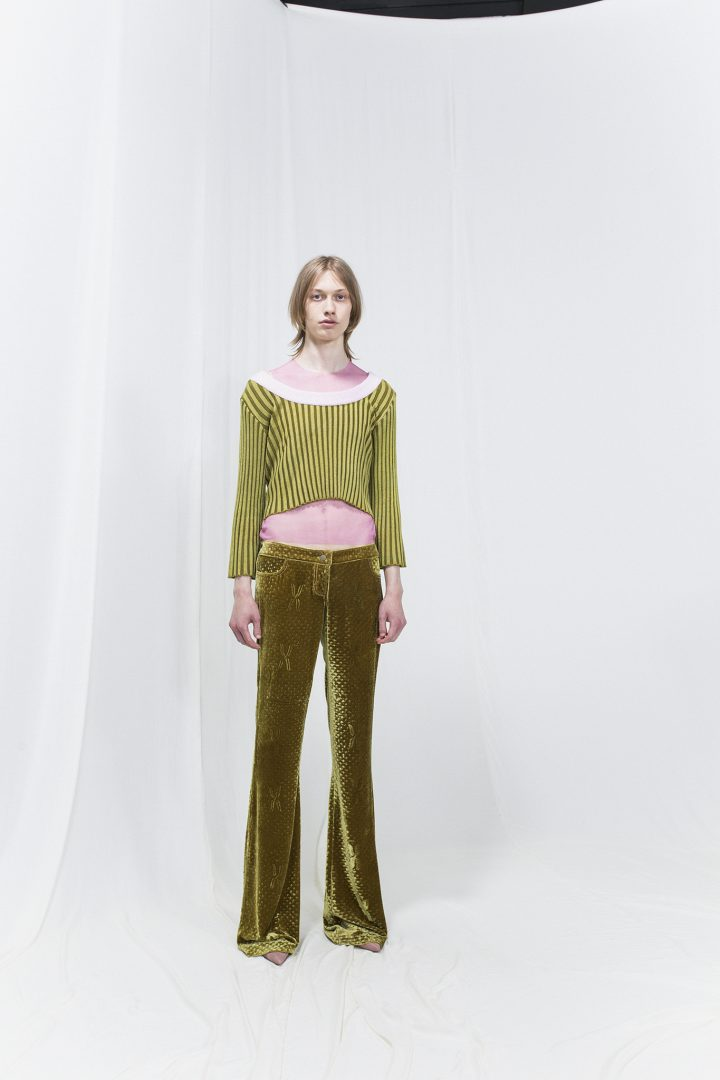 Model wearing an olive green ribbed top finished with pink rib and olive green satin trousers