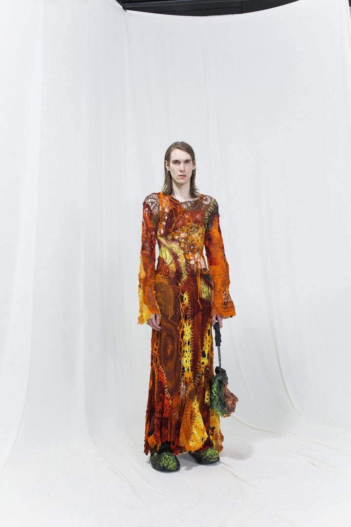 Model is wearing a brown & yellow crochet dress with flared sleeves, multicoloured melting bag