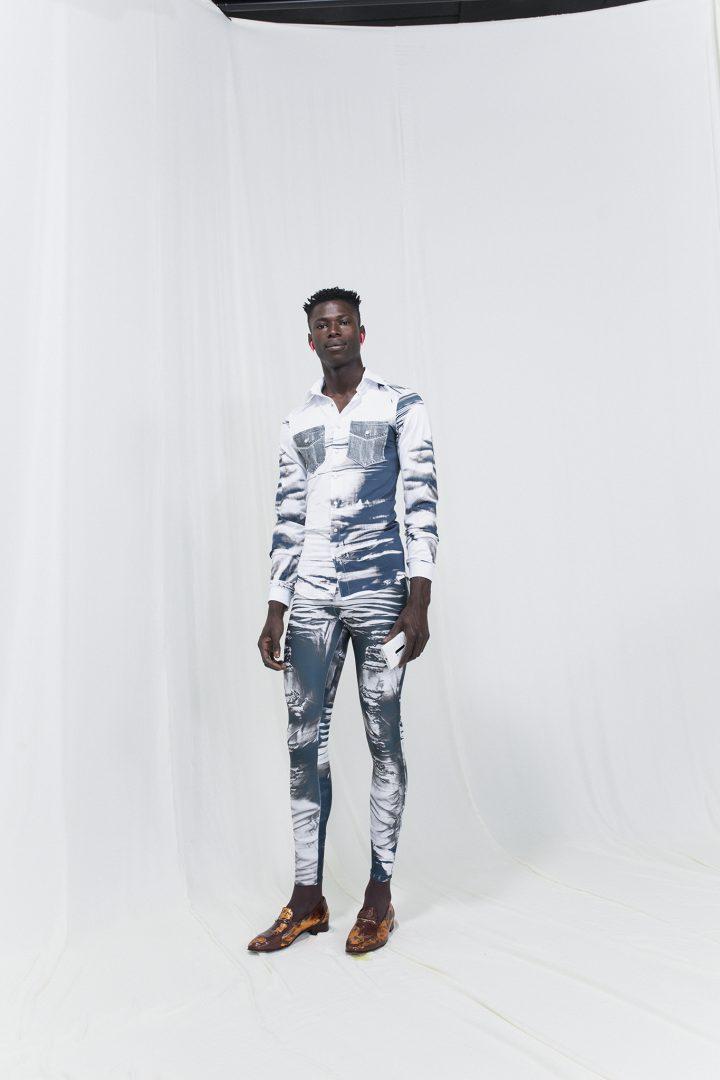 Model is wearing a denim imitation shirt and skinny-leg trousers