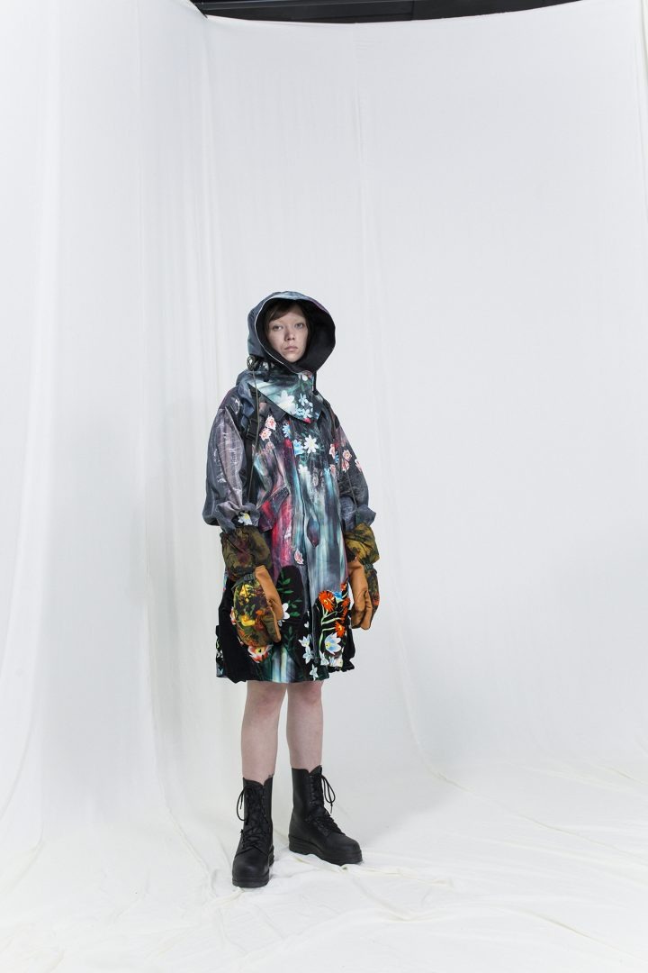Model is wearing a melted floral parka with matching velvet skirt, hood and gloves