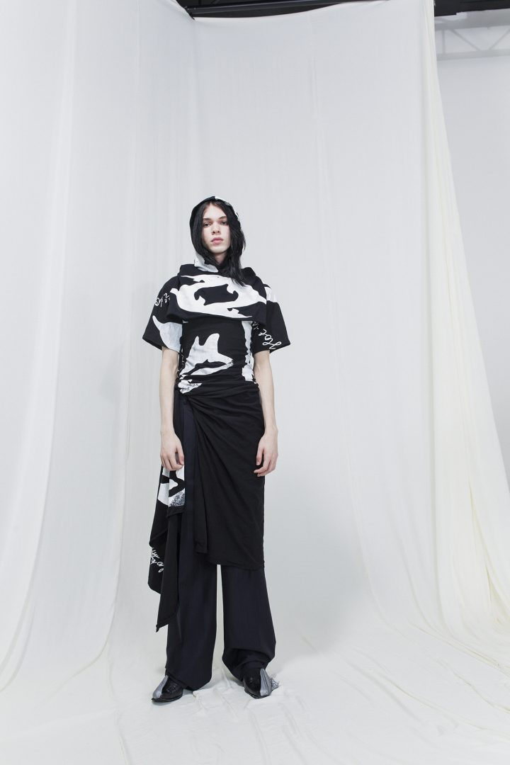 Model wearing a Black & white hooded dress with t-shirt sleeves