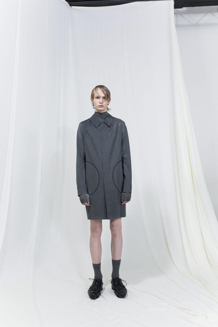 Model wearing long dark grey shirt