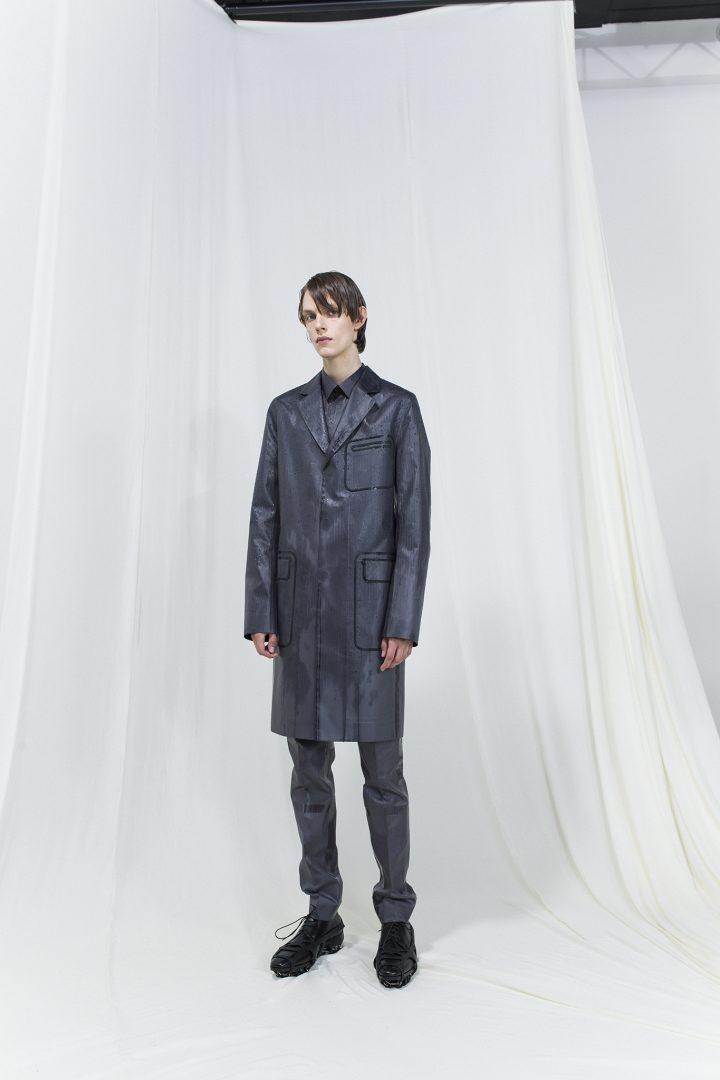 Model wearing dark grey long blazer and matching long trouser